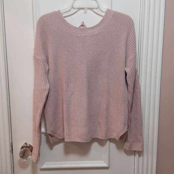 Pink knit sweater with tie in the back